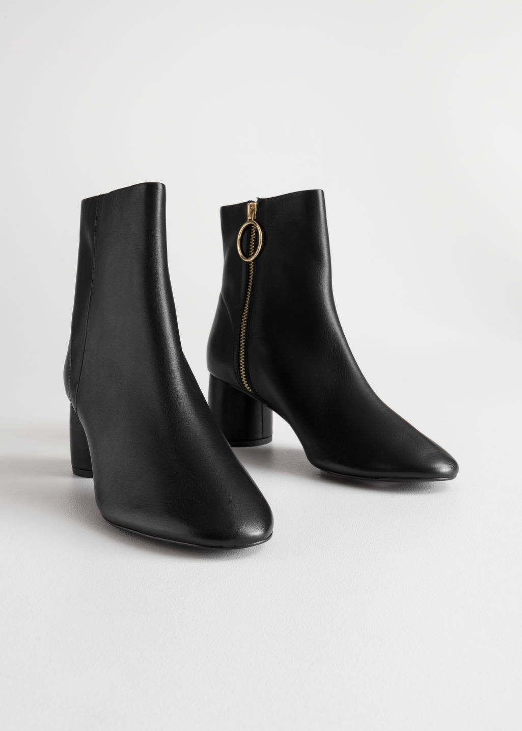 Back image of Stories cylinder heel ankle boots in black