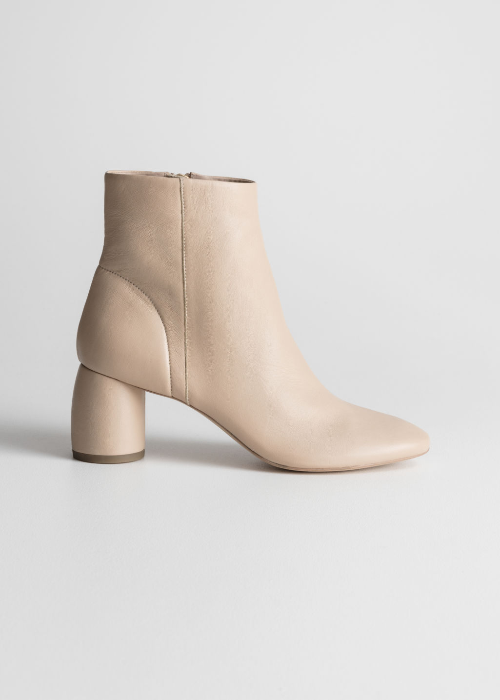 Front image of Stories cylinder heel ankle boots in beige