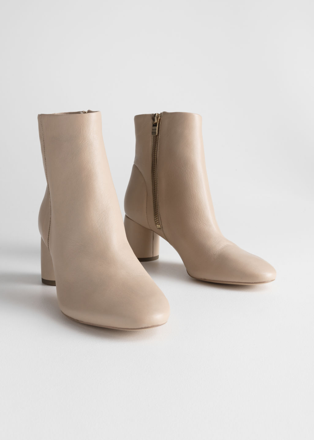 Back image of Stories cylinder heel ankle boots in beige