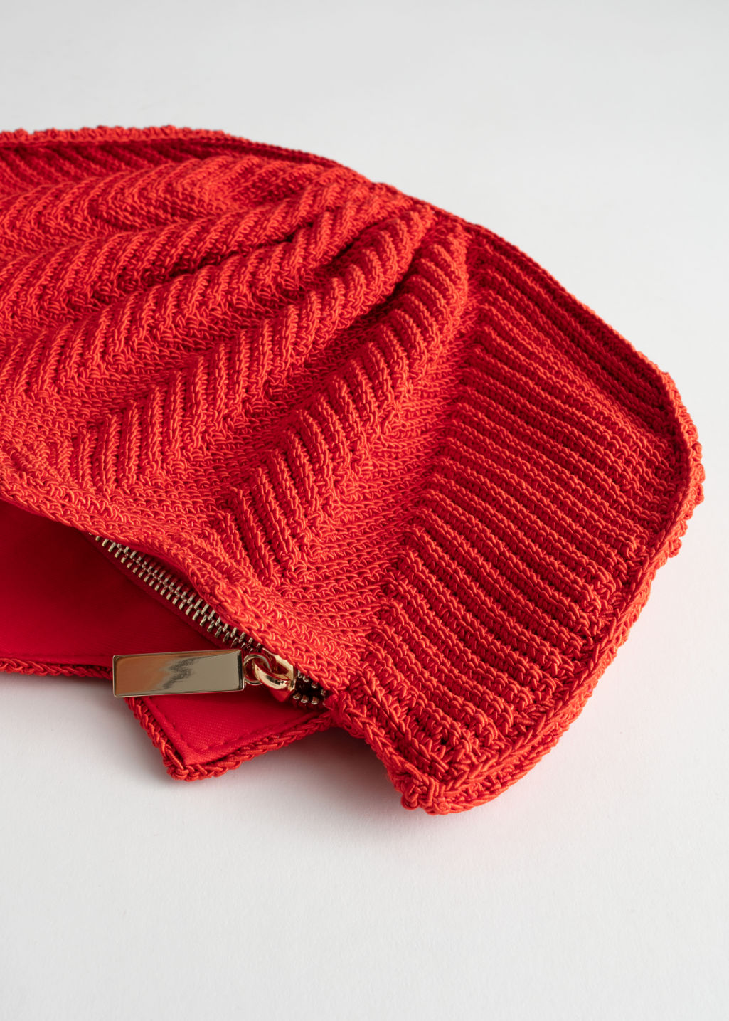 Back image of Stories crochet lotus clutch in red