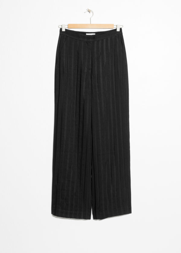 Front image of Stories linen blend stripe trousers in black