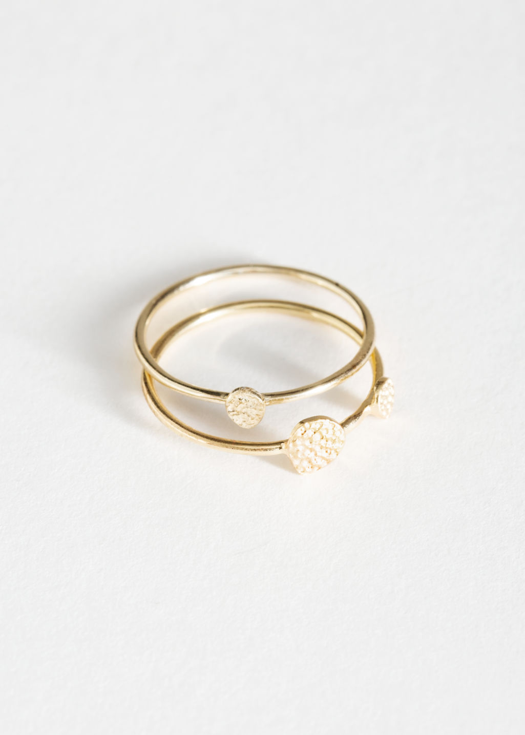 Front image of Stories hammered disc charm ring in gold