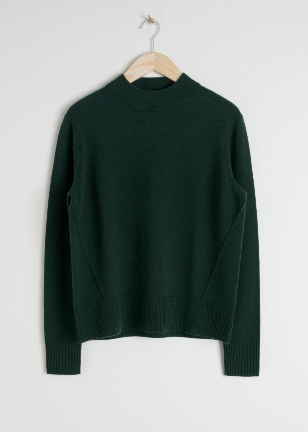 Front image of Stories relaxed fit cashmere sweater in green