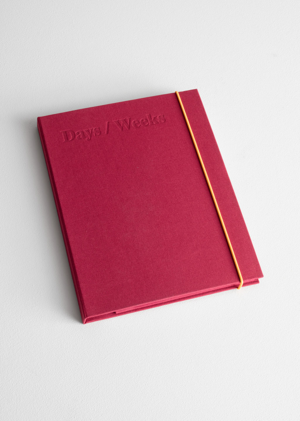 Front image of Stories days and weeks a5 notebook in red
