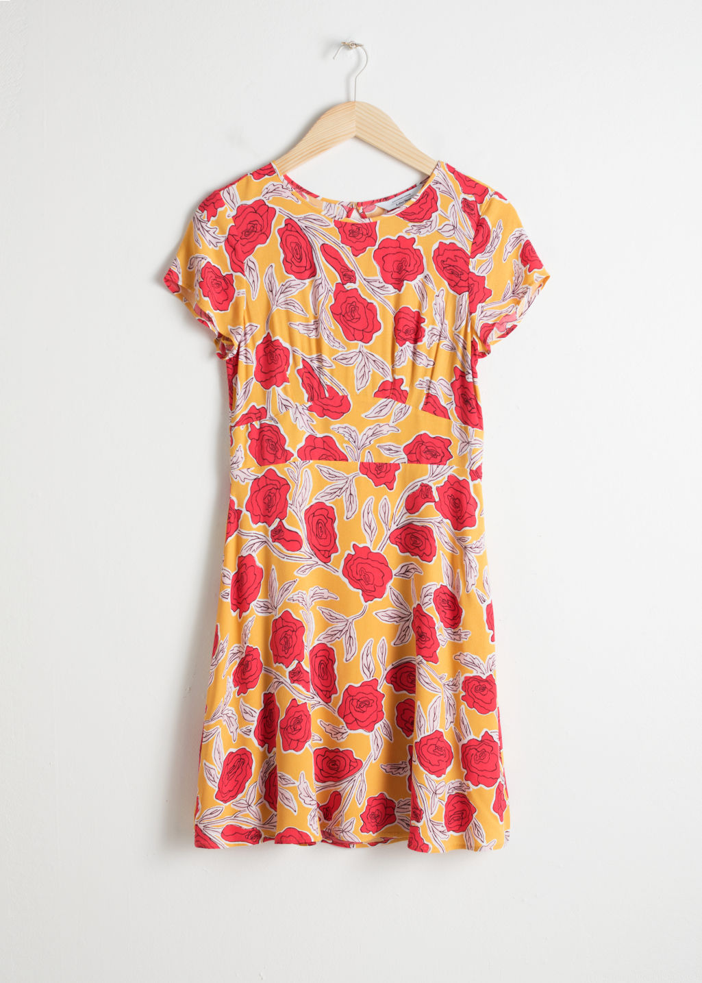 Front image of Stories floral printed skater dress in yellow