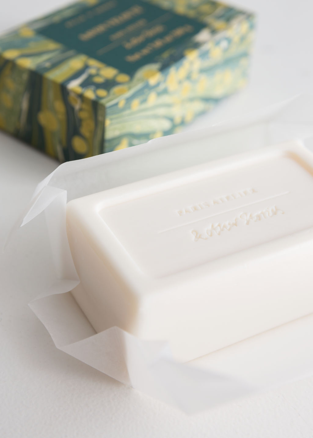 Back image of Stories savon velouté bar soap in white