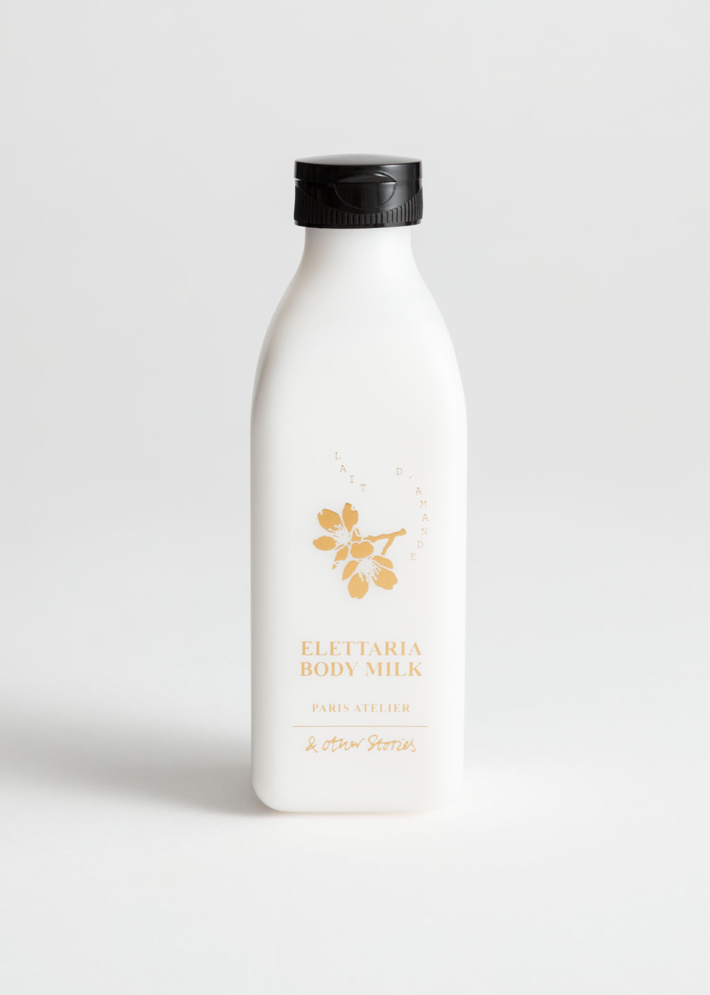 Front image of Stories body milk in white