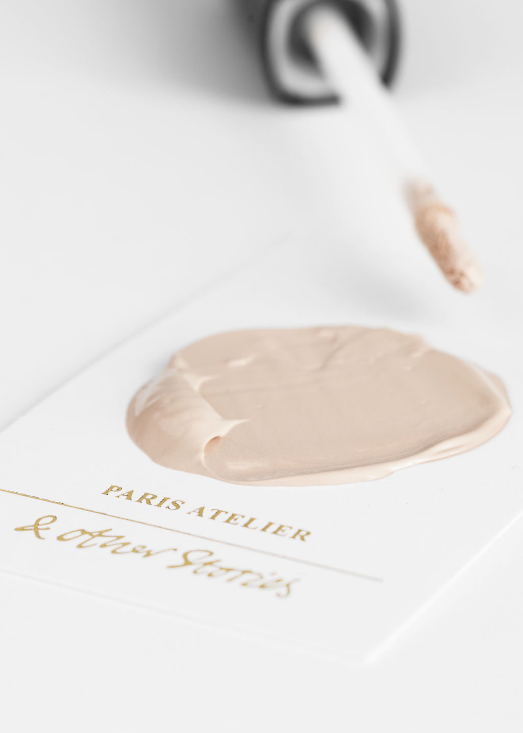 Back image of Stories concealer in white