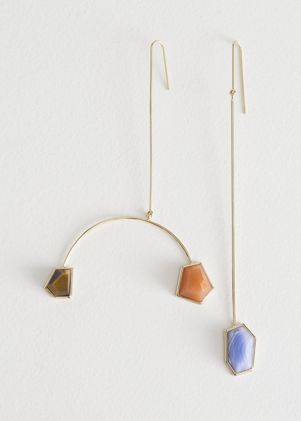 Front image of Stories asymmetrical mobile stone earrings in blue