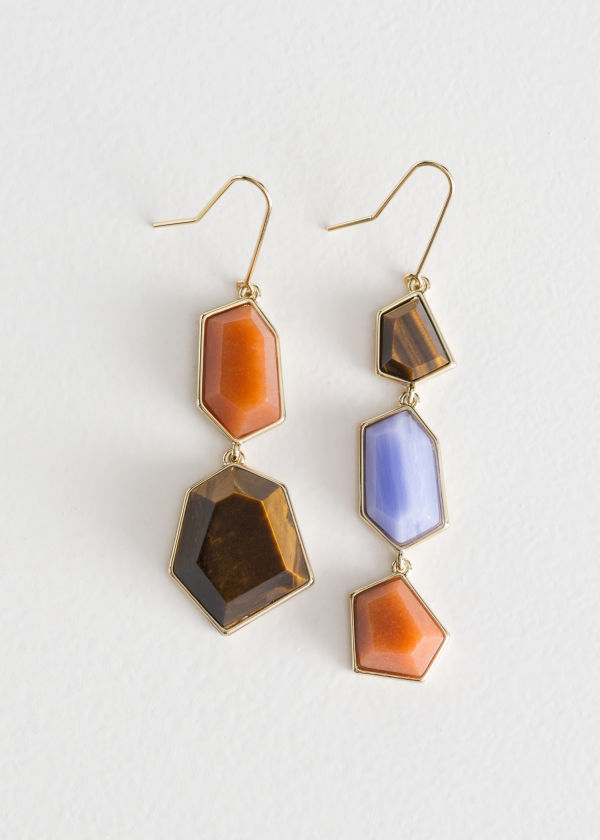 Front image of Stories asymmetric jewel stone earrings in blue