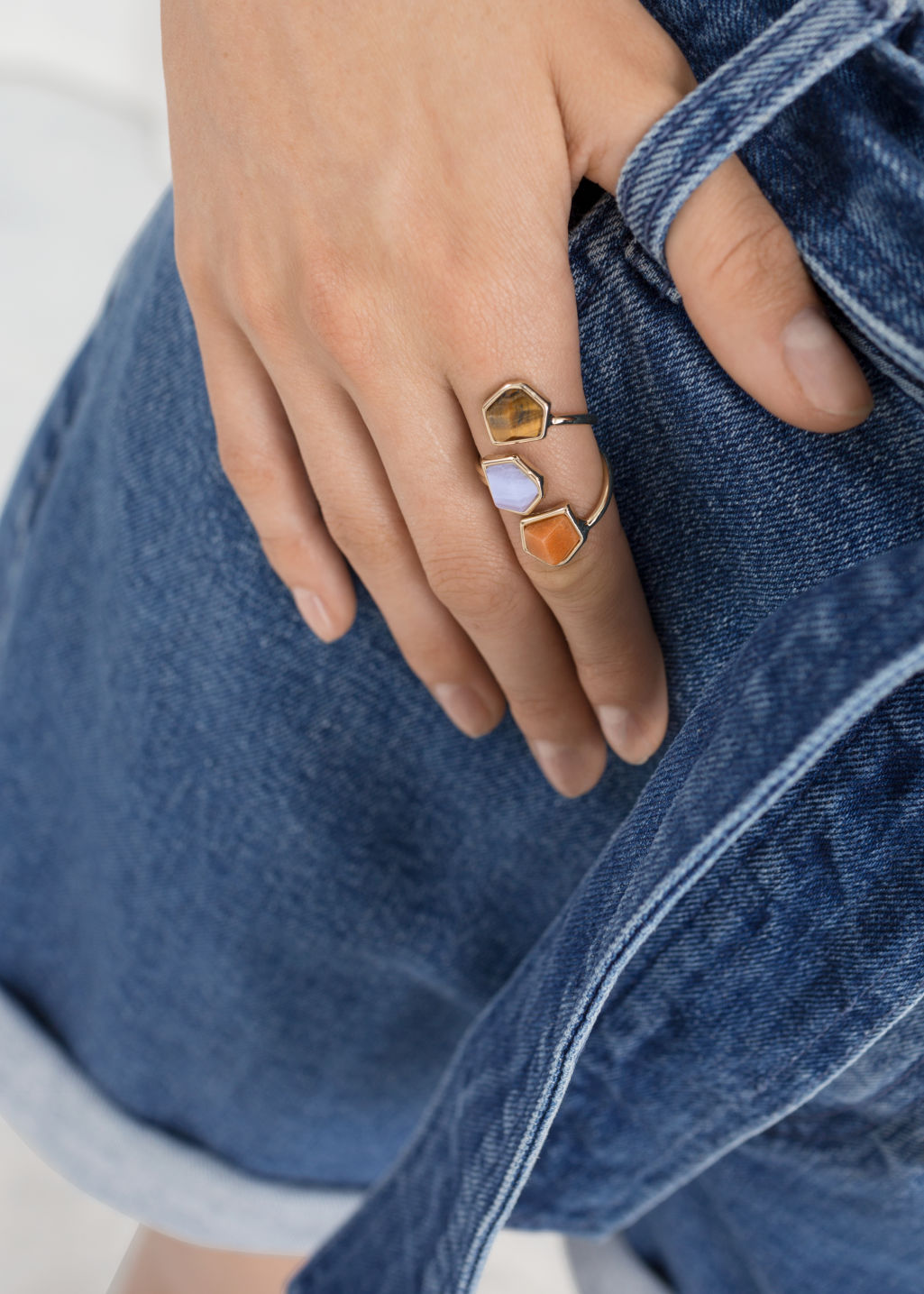 Back image of Stories trio stone swirl ring in blue