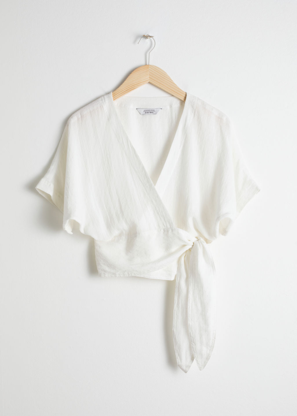 Front image of Stories belted wrap blouse in white
