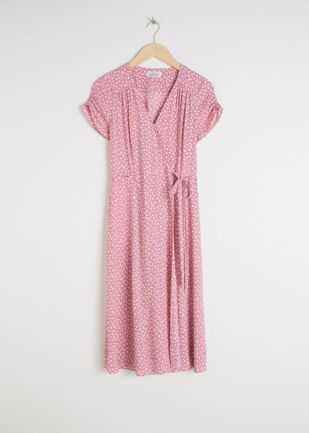 Front image of Stories floral printed wrap dress in pink