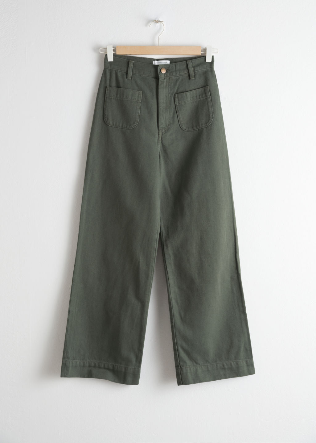Front image of Stories high waisted twill trousers in green