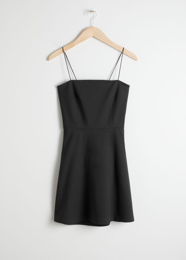 Front image of Stories tie back mini dress in black