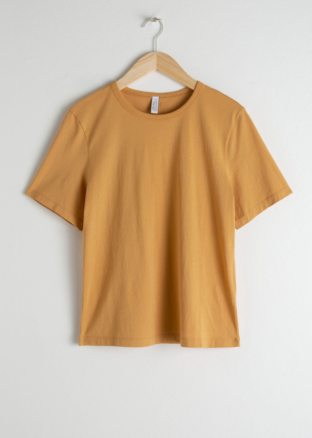 Front image of Stories organic cotton tee in yellow