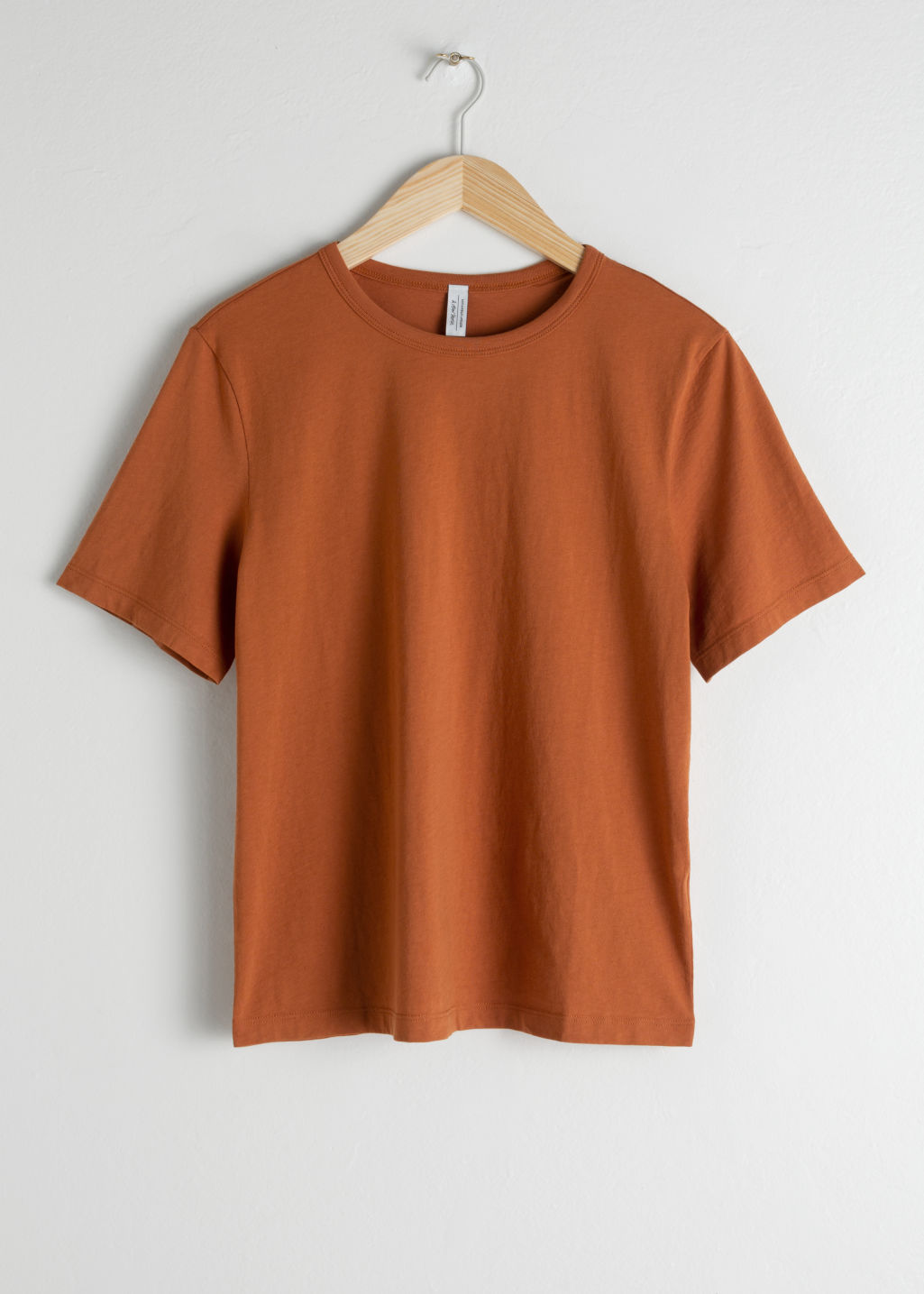 Front image of Stories organic cotton tee in orange