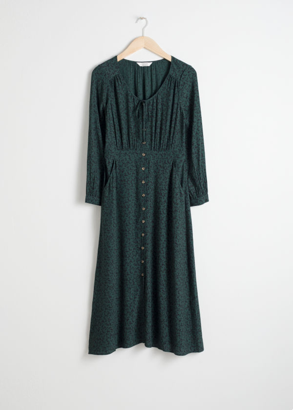 Front image of Stories printed button down midi dress in green