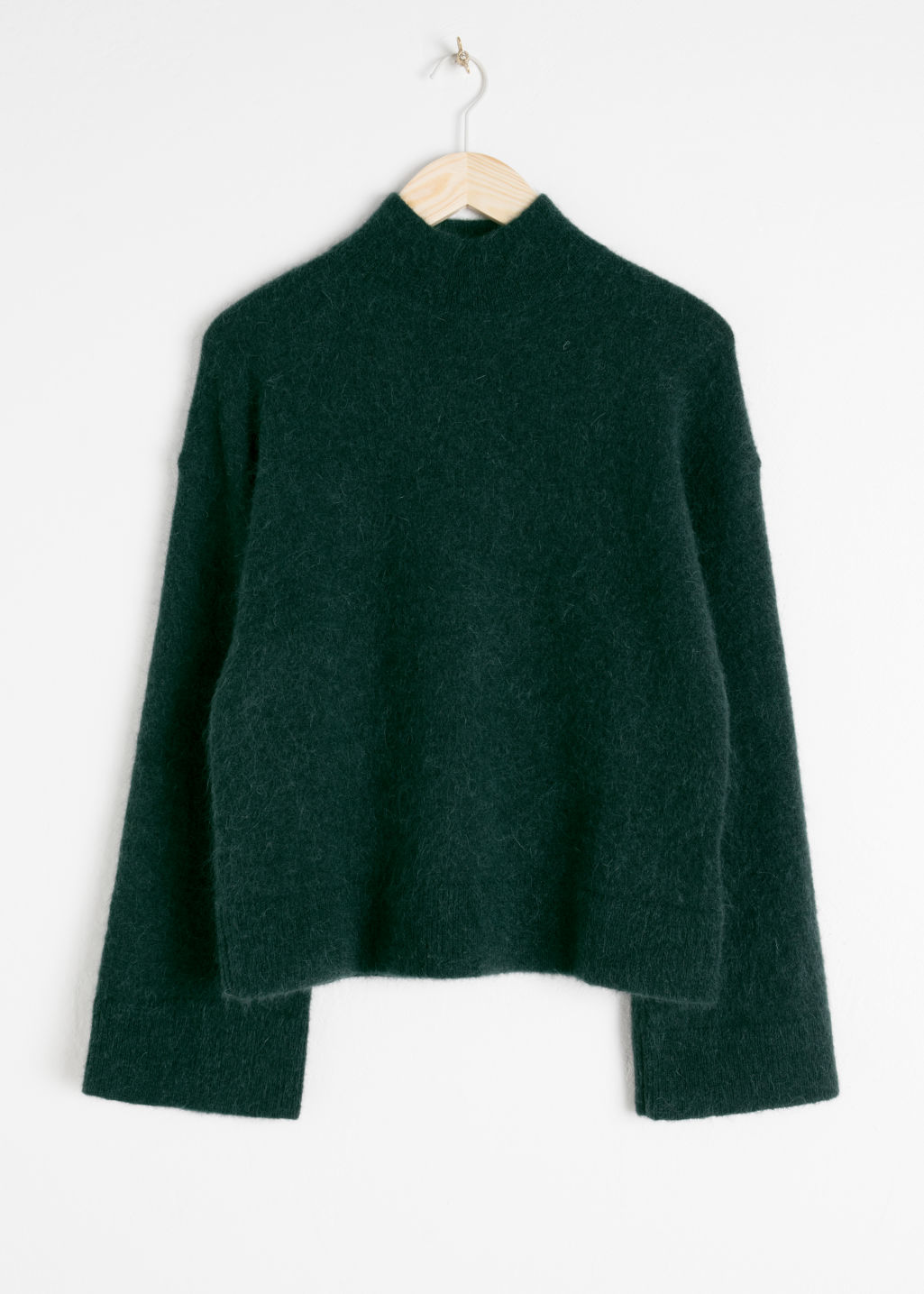 Front image of Stories bell sleeve turtleneck sweater in green
