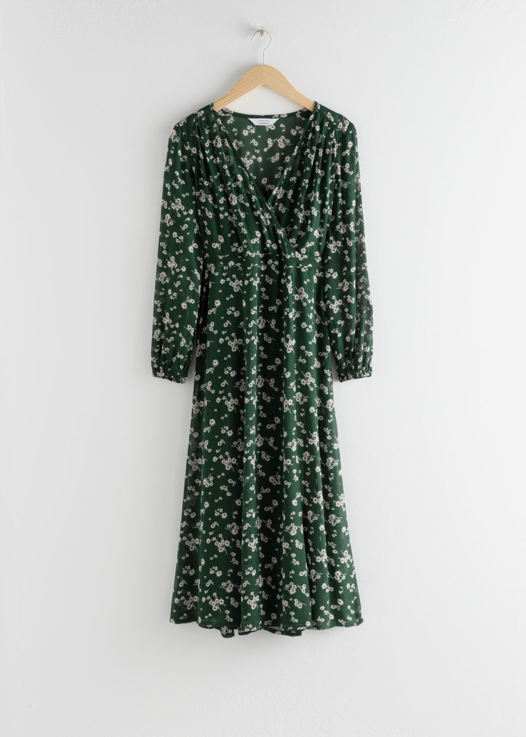 Front image of Stories sheer printed midi dress in green