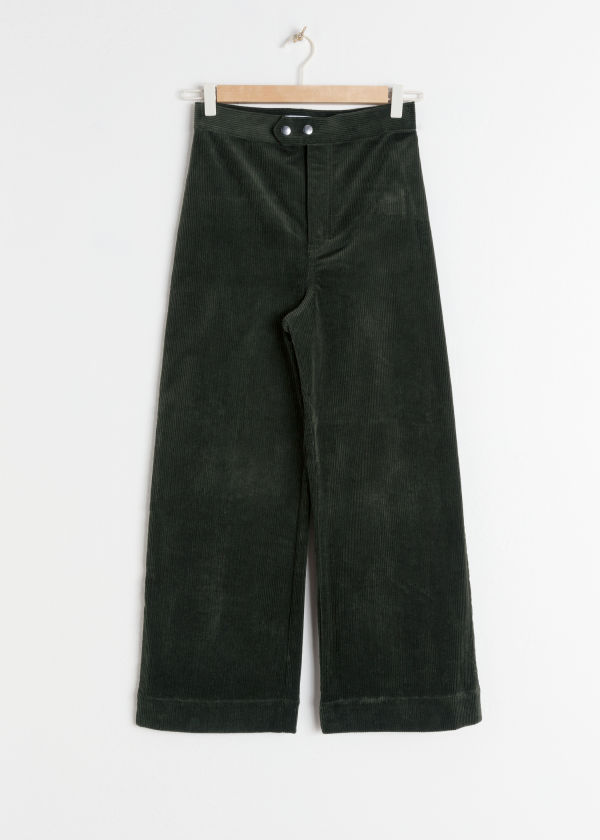 Front image of Stories duo snap button corduroy culottes in green