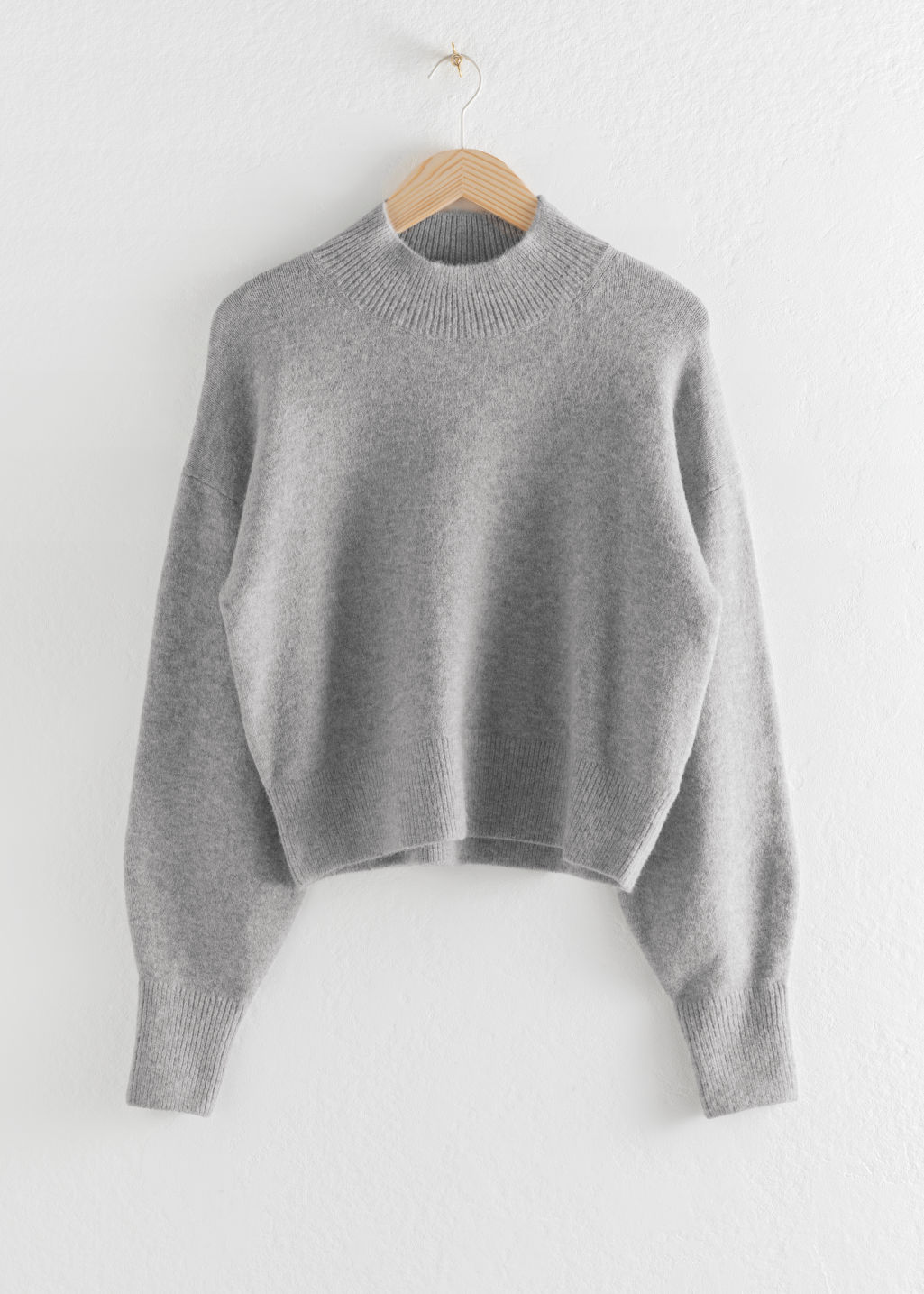 Front image of Stories mock neck sweater in grey
