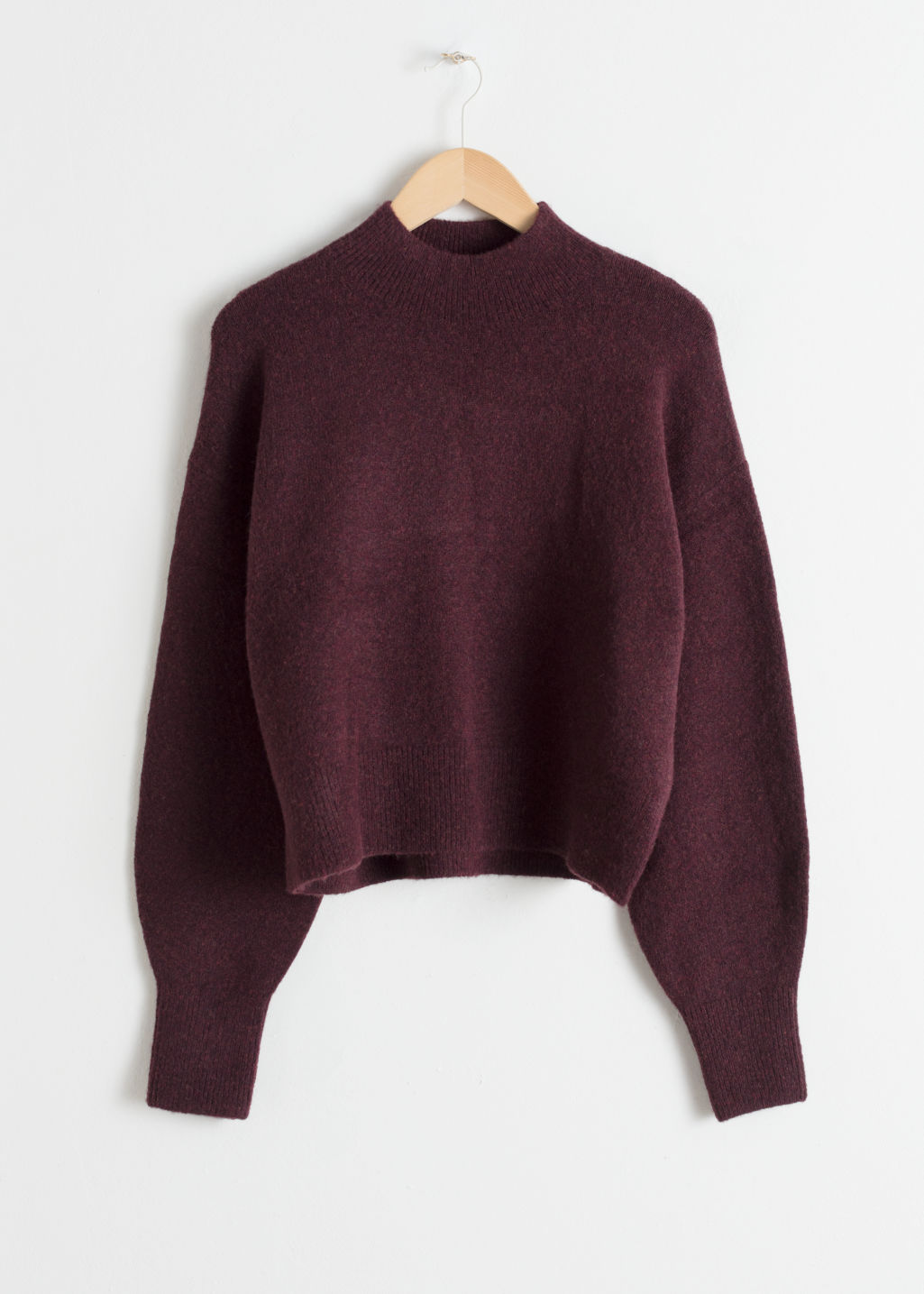Front image of Stories mock neck sweater in red