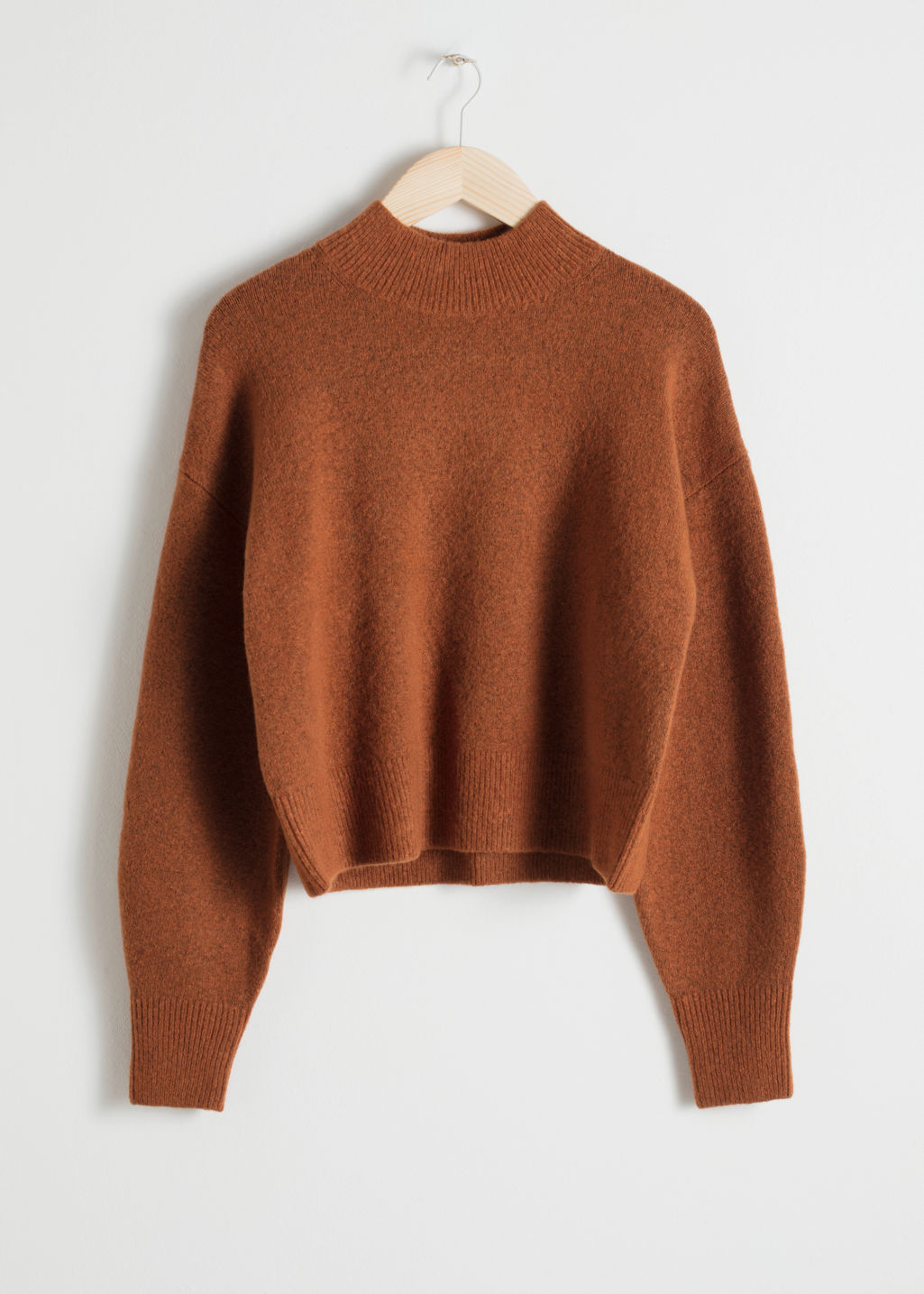 Front image of Stories mock neck sweater in orange