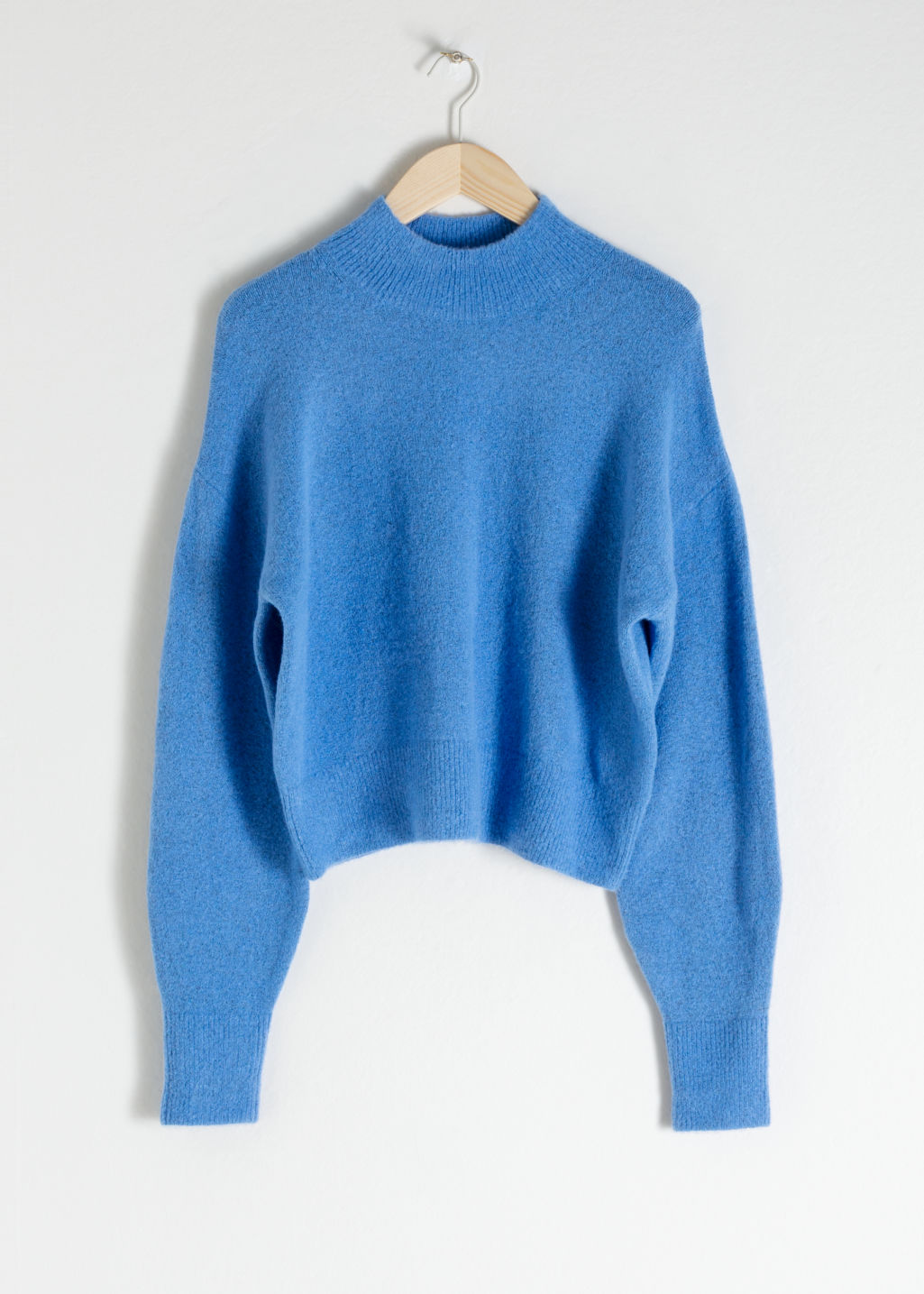 Front image of Stories mock neck sweater in blue