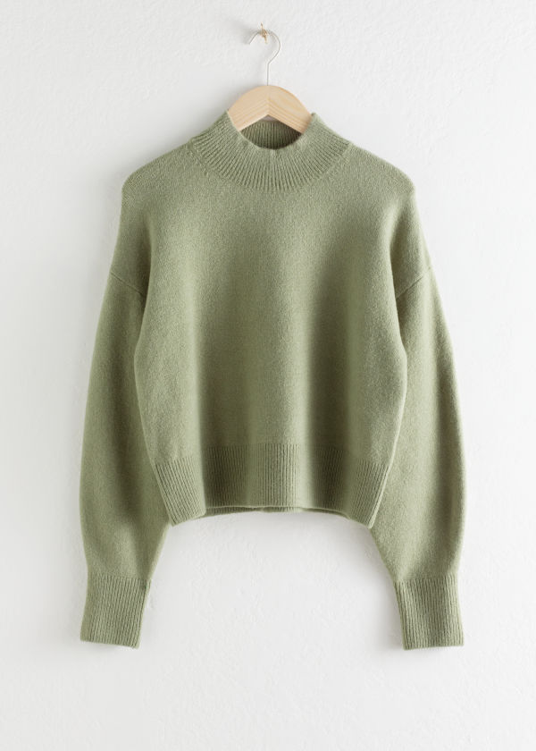 Front image of Stories mock neck sweater in green