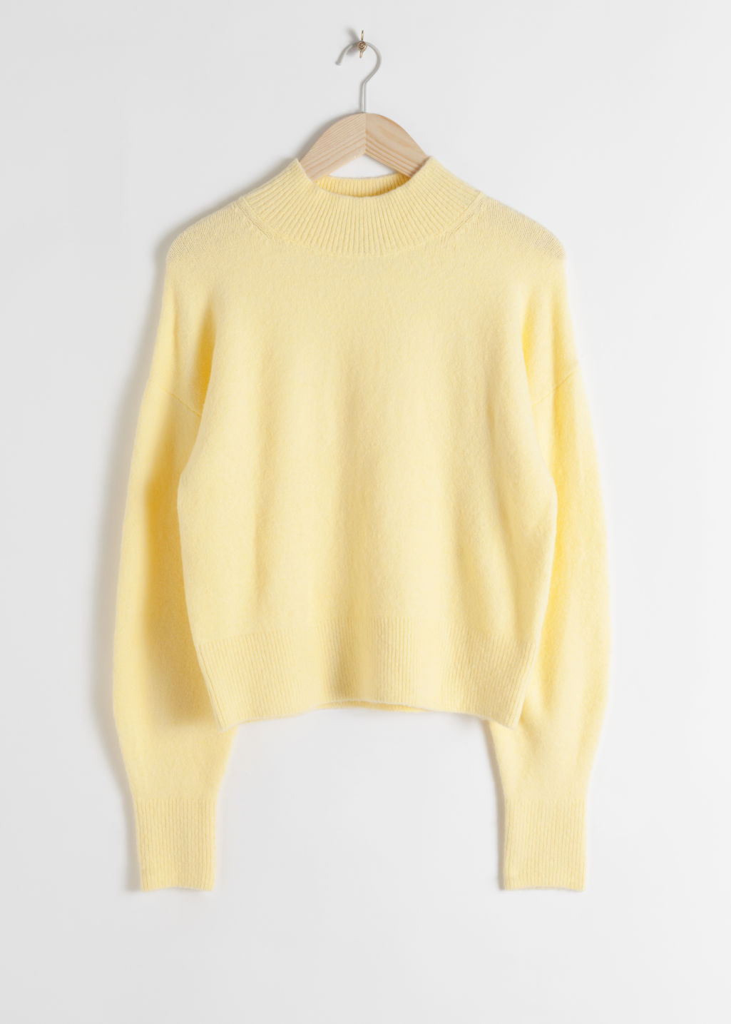 Front image of Stories mock neck sweater in yellow