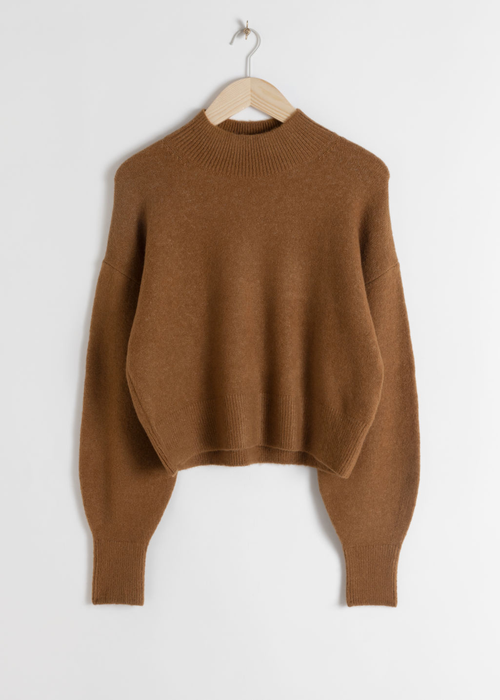 Front image of Stories mock neck sweater in beige