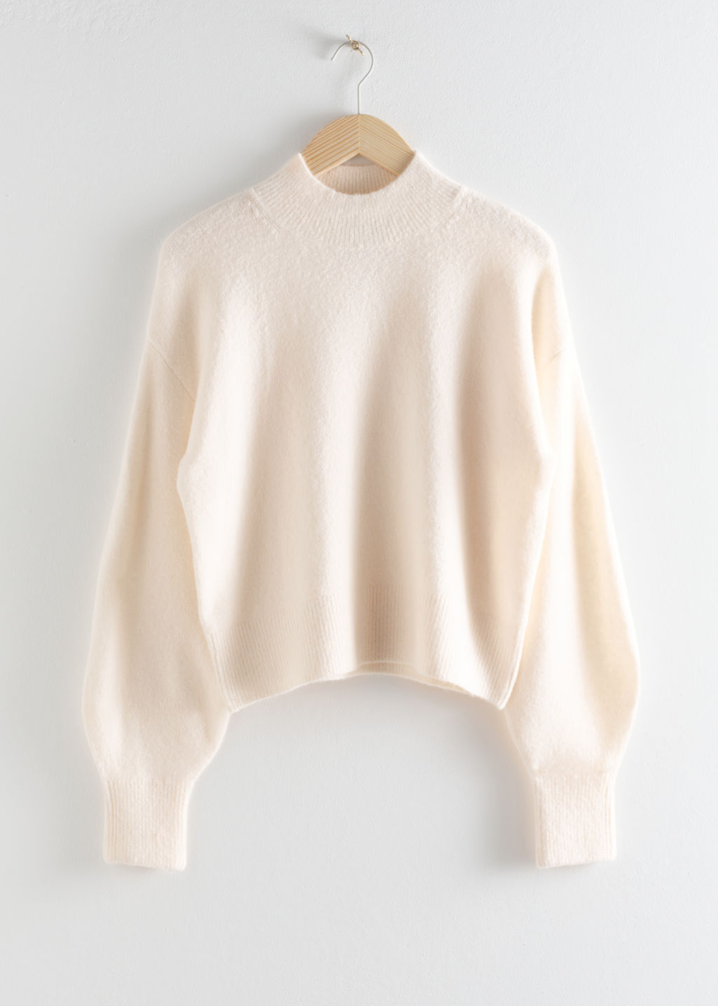 Front image of Stories mock neck sweater in white