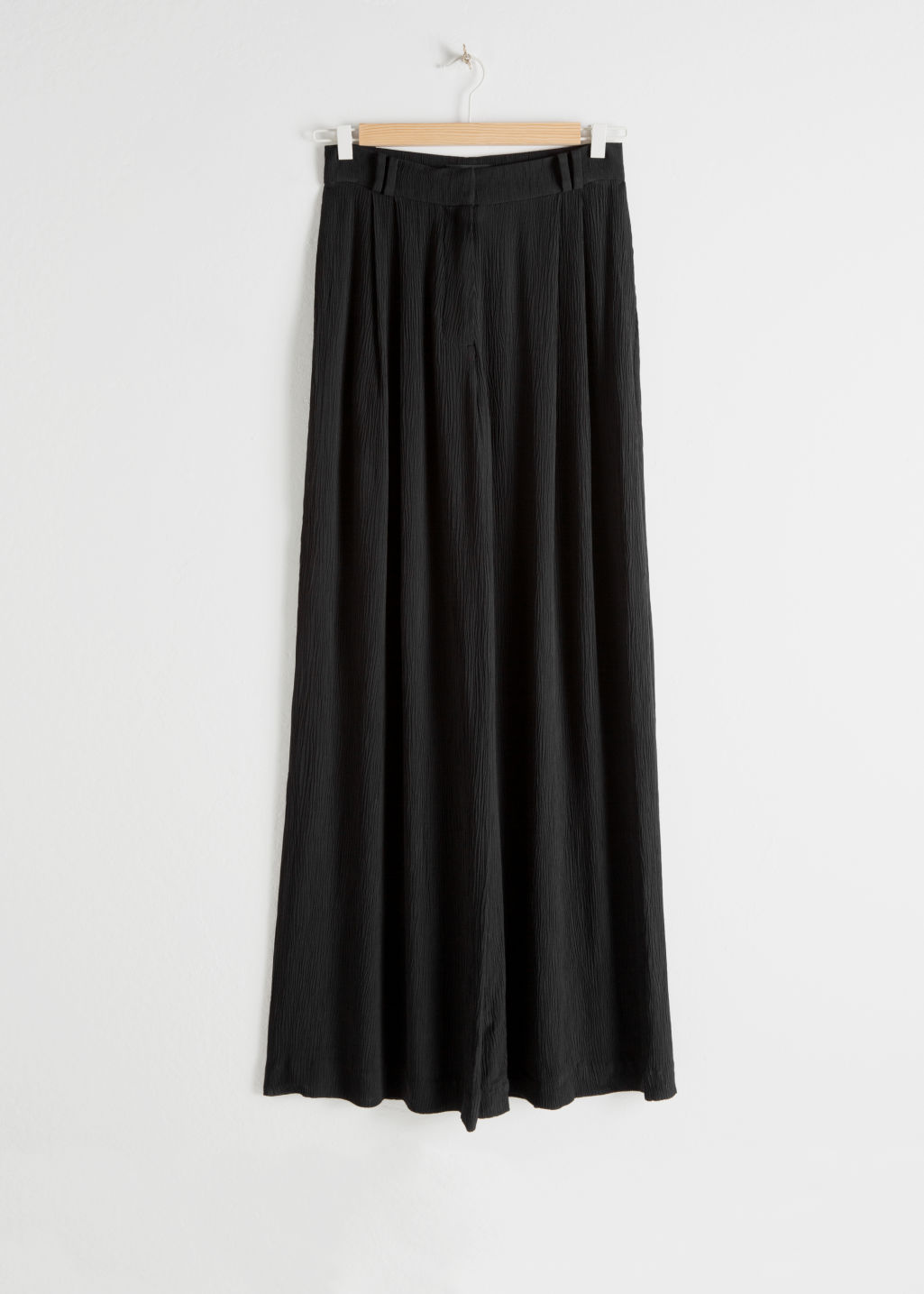 Front image of Stories high waisted wide trousers in black