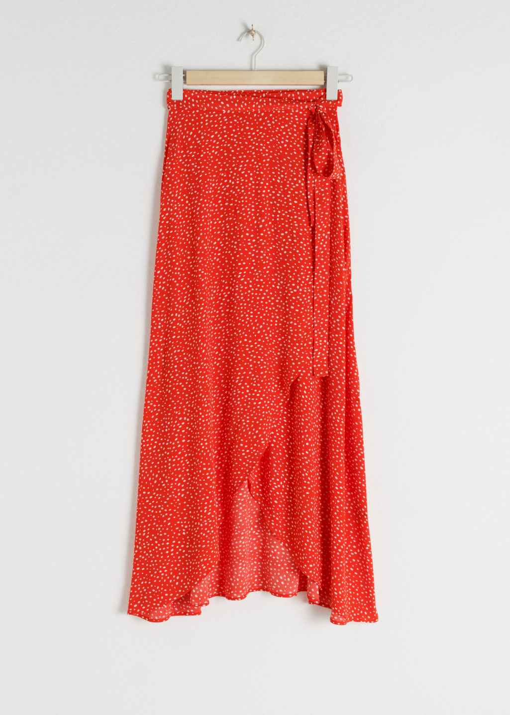 Front image of Stories asymmetric wrap midi skirt in red