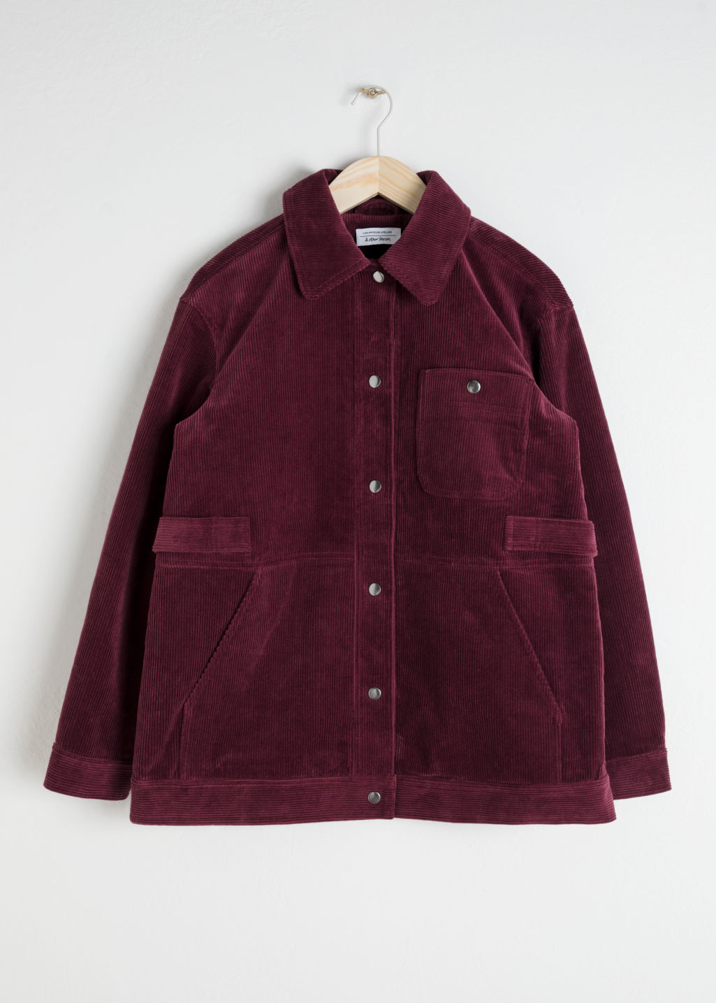 Front image of Stories oversized corduroy workwear jacket in red