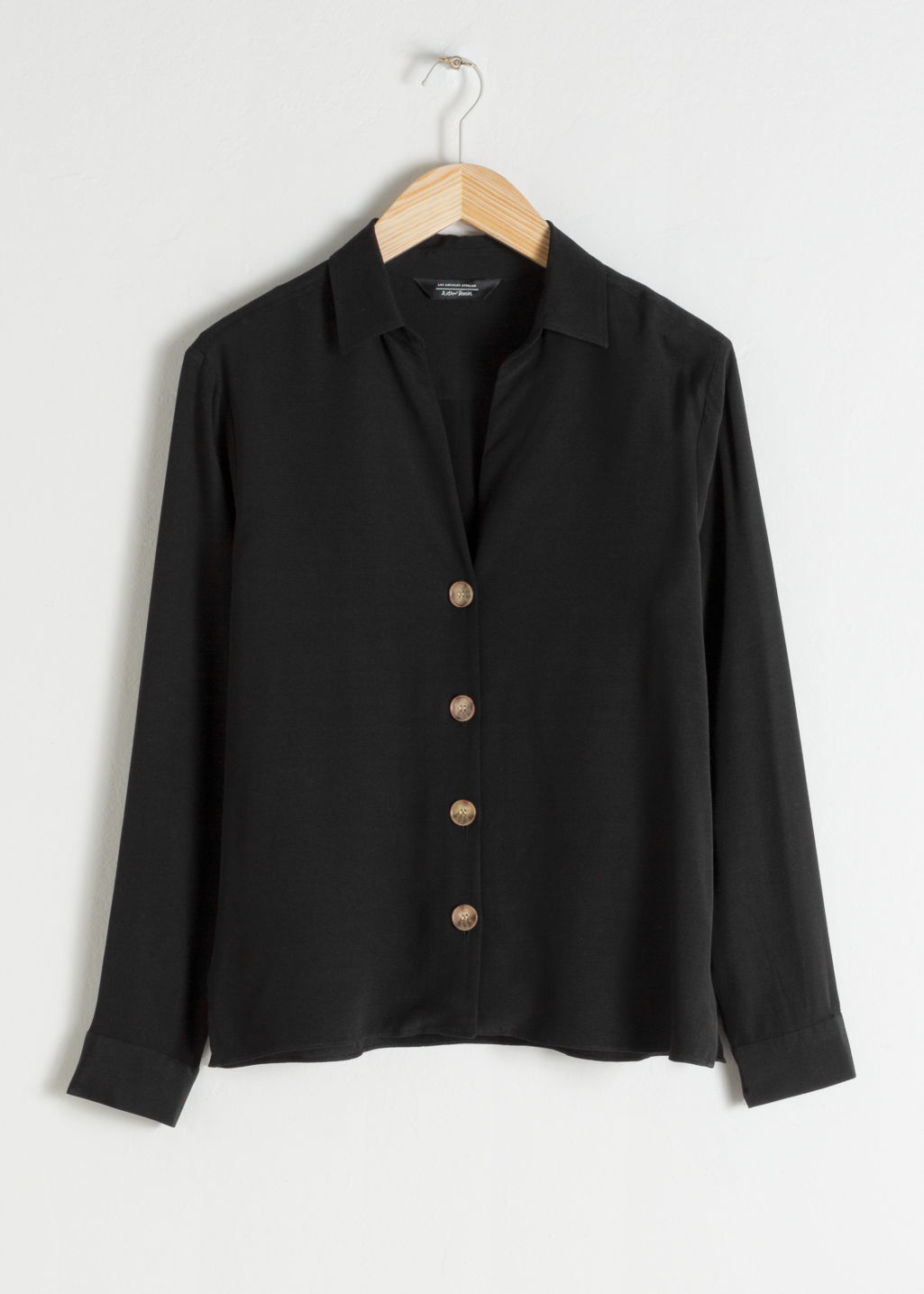 Front image of Stories relaxed fit button up in black