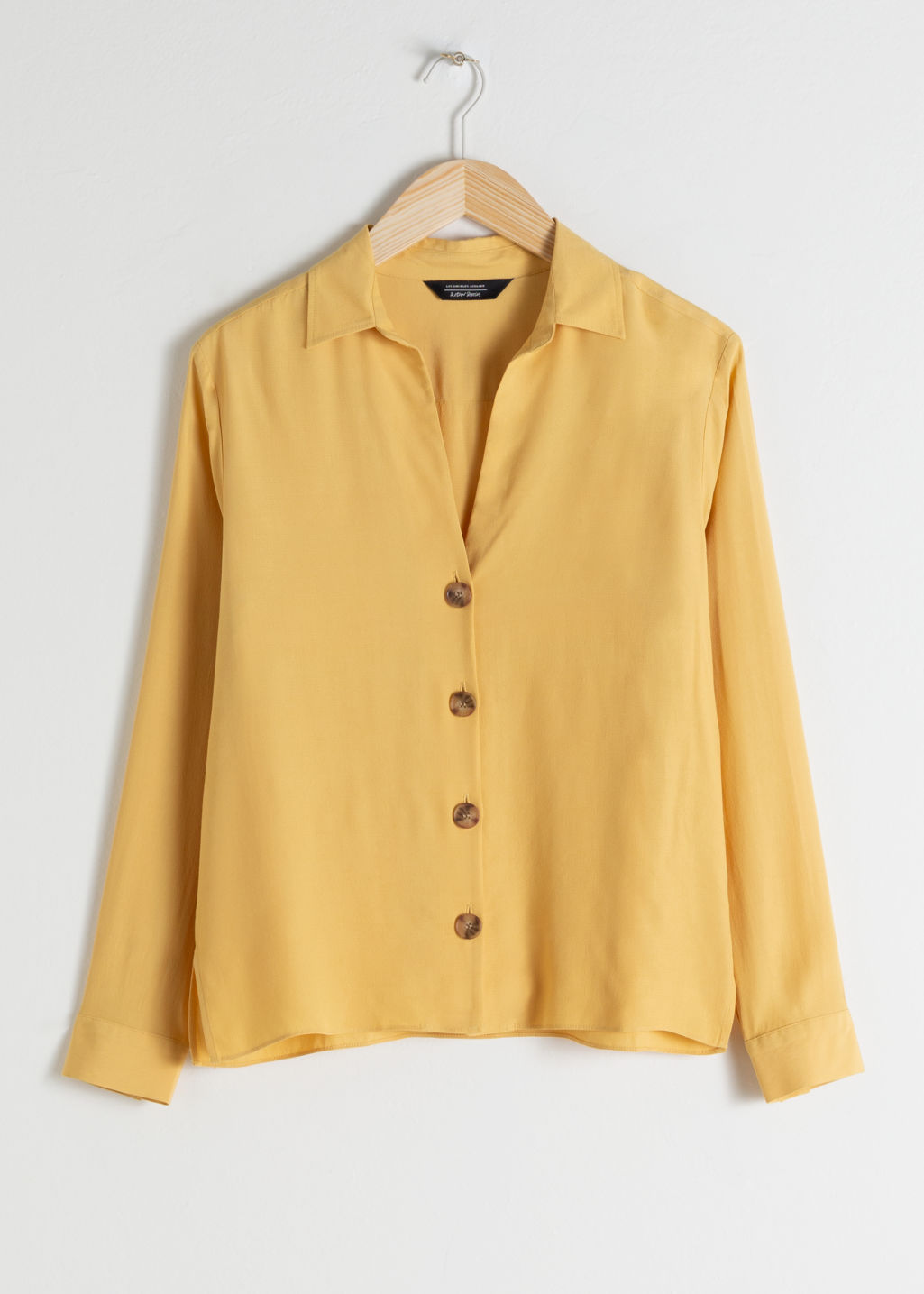 Front image of Stories relaxed fit button up in yellow