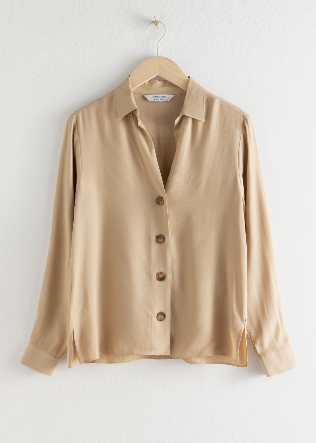 Front image of Stories relaxed fit button up in beige