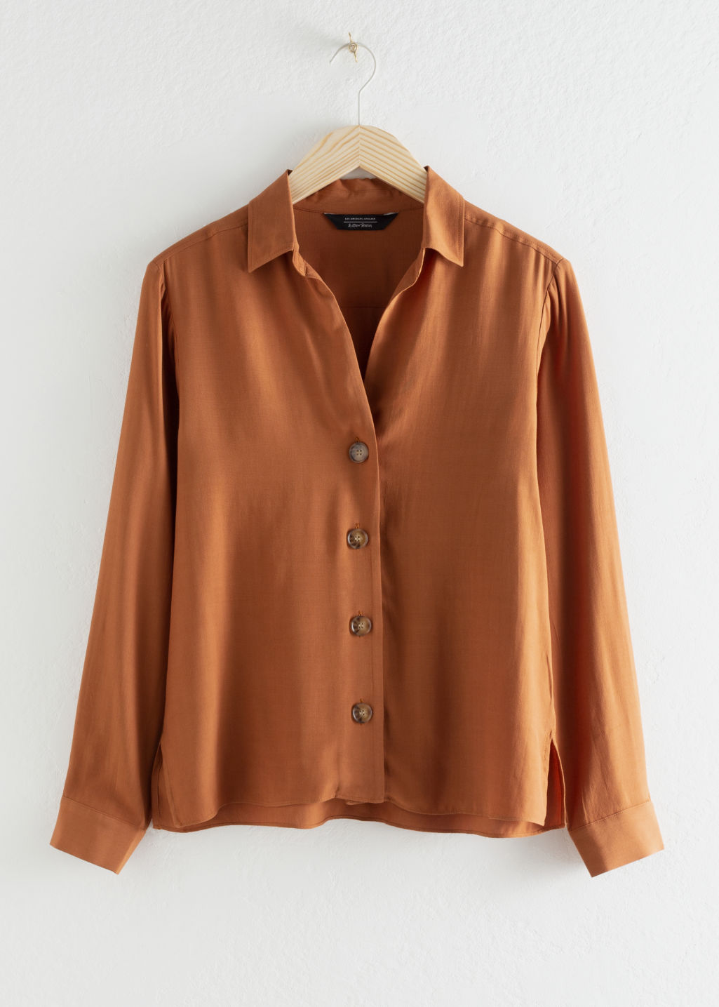 Front image of Stories relaxed fit button up in orange