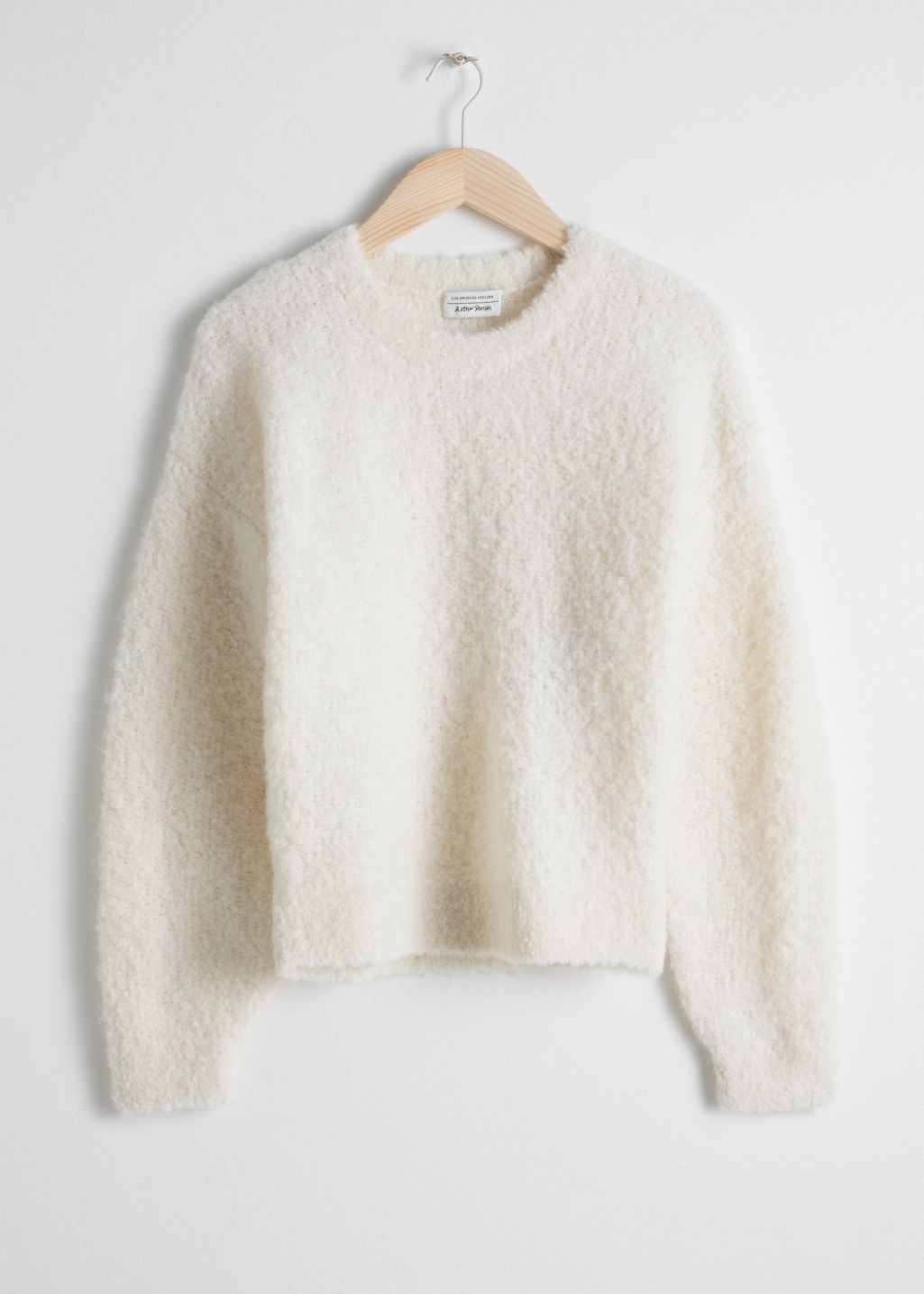 Front image of Stories textured wool blend sweater in white