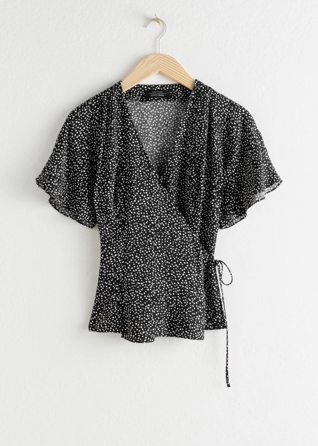 Front image of Stories printed wrap blouse  in black