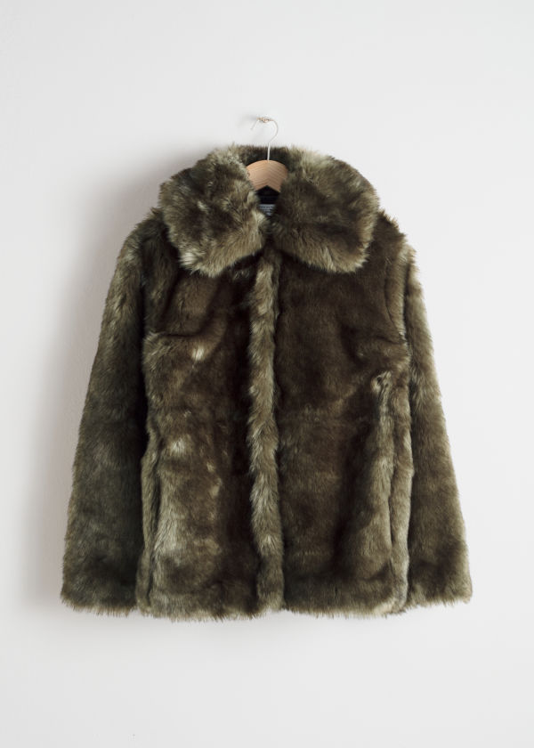 Front image of Stories short faux fur jacket in green