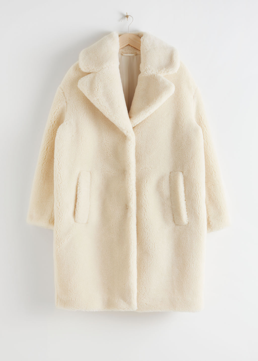 Front image of Stories faux shearling coat in yellow