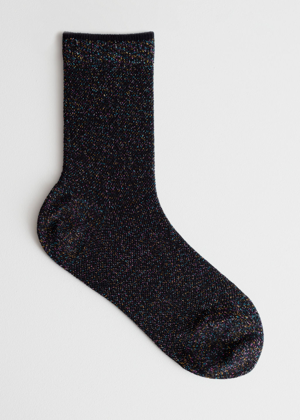Front image of Stories glitter ankle socks in black