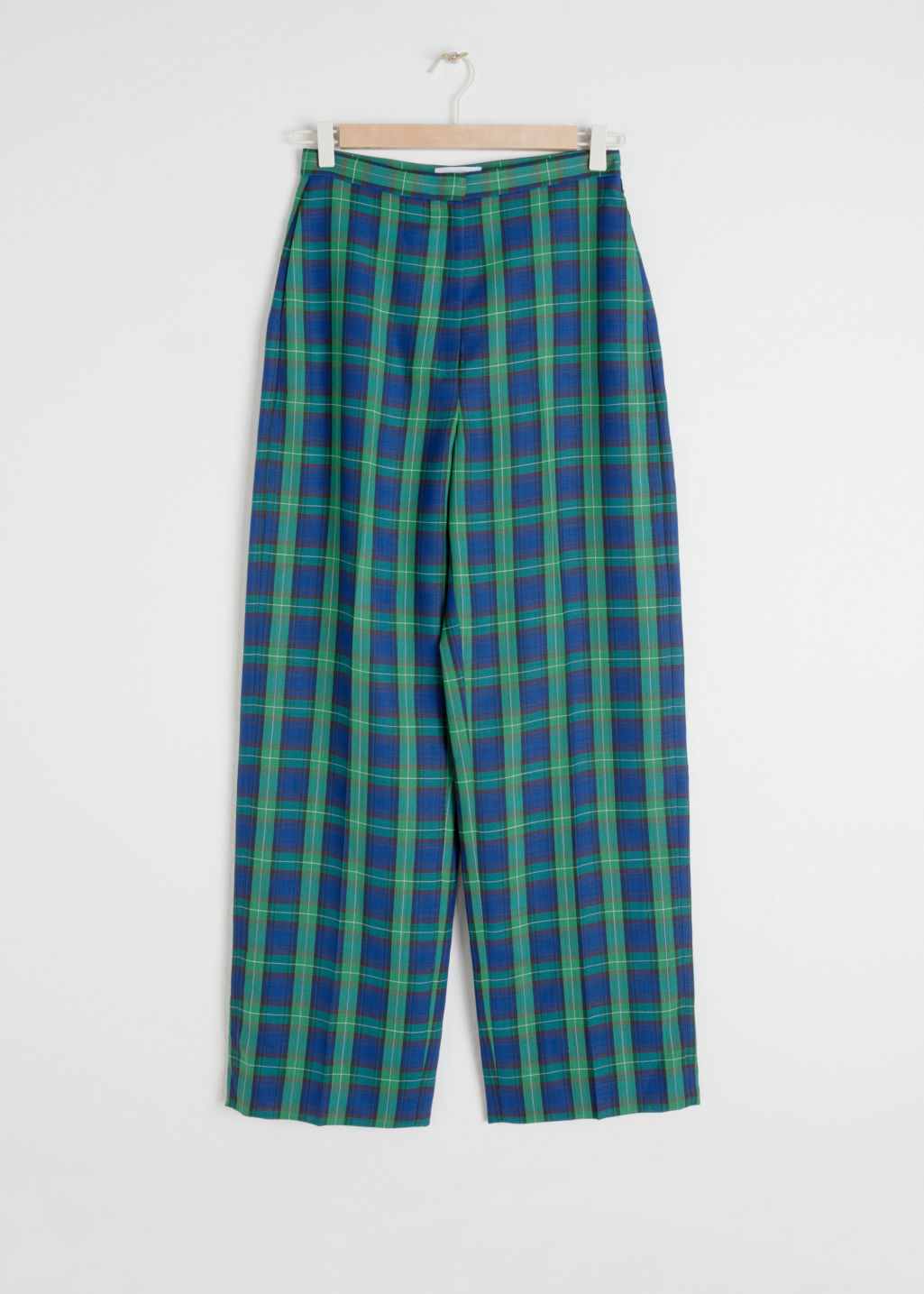 Front image of Stories wool blend plaid trousers in green