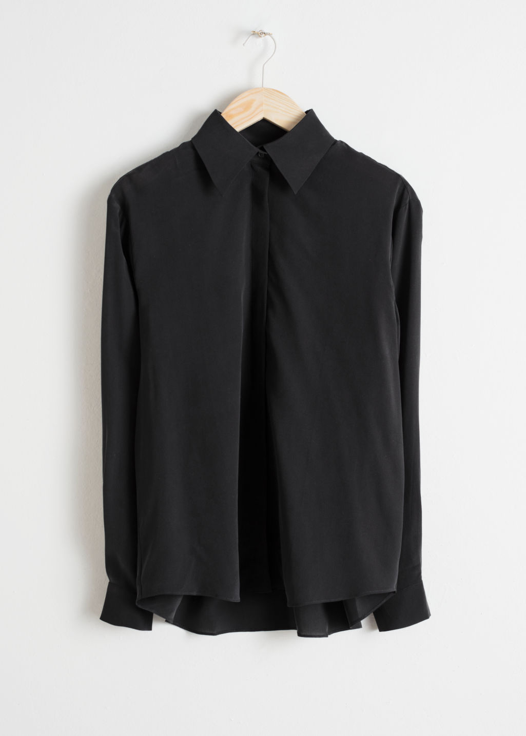 Front image of Stories pointed collar silk shirt in black