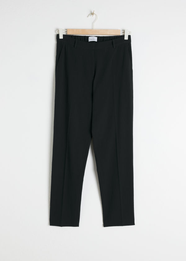Front image of Stories striped tailored trousers in black