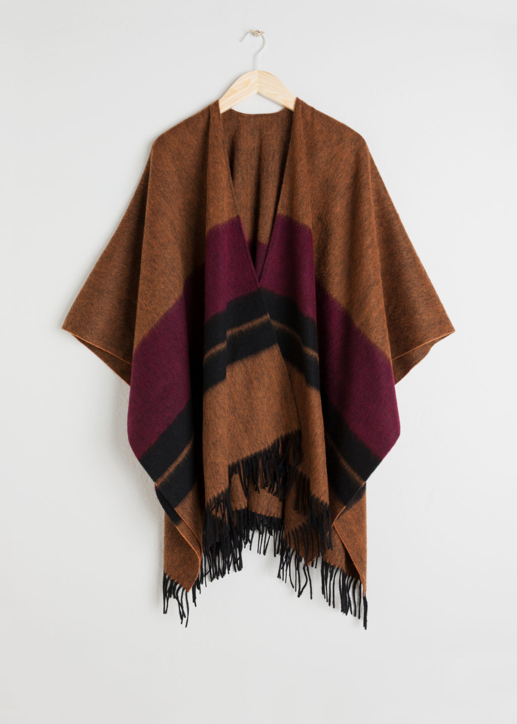 Front image of Stories wool blanket poncho in orange