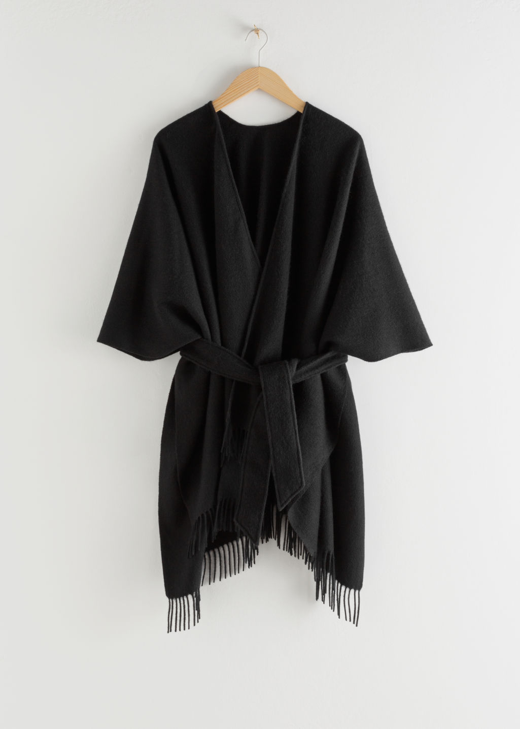 Front image of Stories wool blanket poncho in black